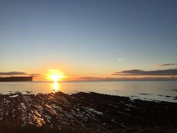 Sun setting at Marwick Head early January